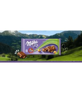 Ciocolata cu lapte si alune intregi 100 g MILKA